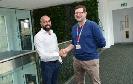 photo of Jaymin Amin, COO Ingenza and John Mackenzie CEO Roslin Innovation Centre shaking hands inside the building - image credit Norrie Russell, UoE