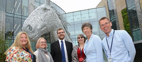 photo of University of Edinburgh management team with MSPs Liz Smith and Oliver Mundell in front of horse statue, Canter - image credit University of Edinburgh