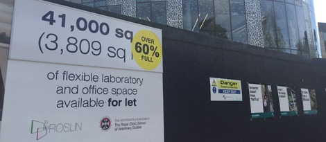photo of hoarding with signage during the development phase of Roslin Innovation Centre